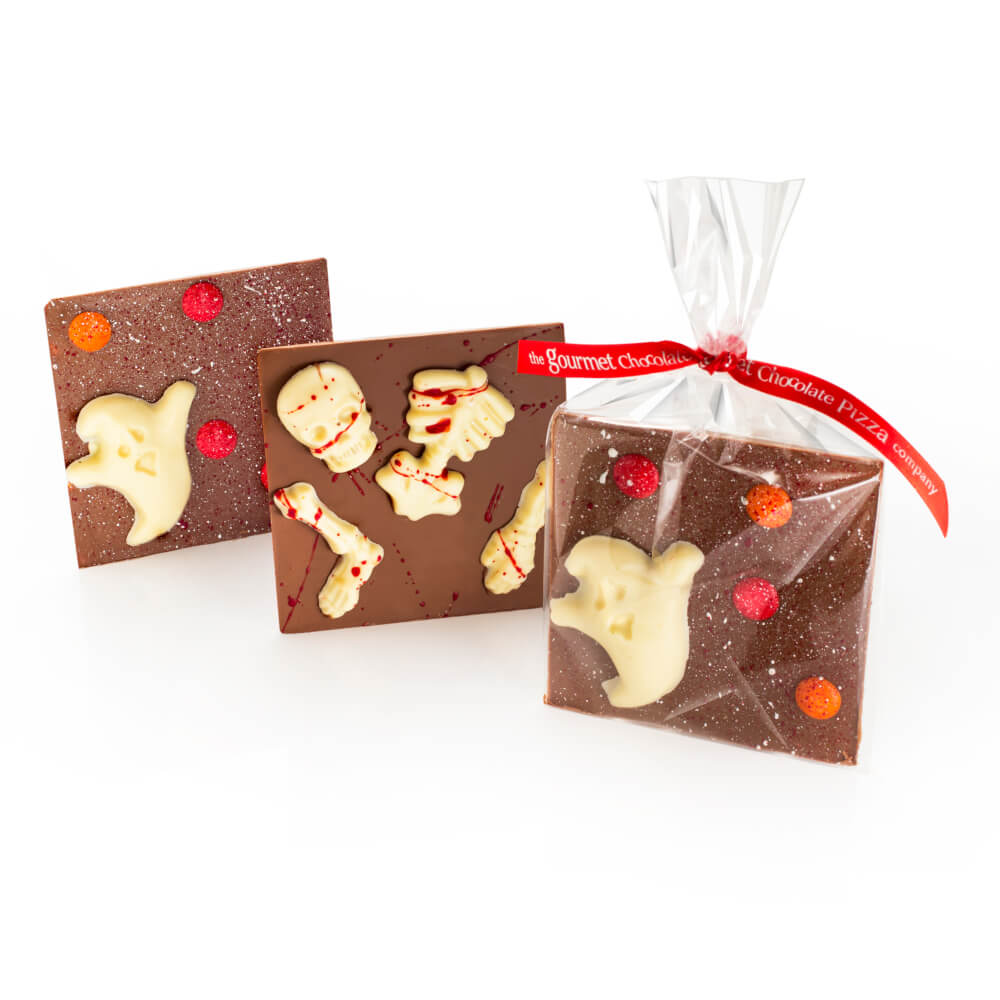 Halloween bars - milk chocolate squares with white chocolate halloween-themed decorations.