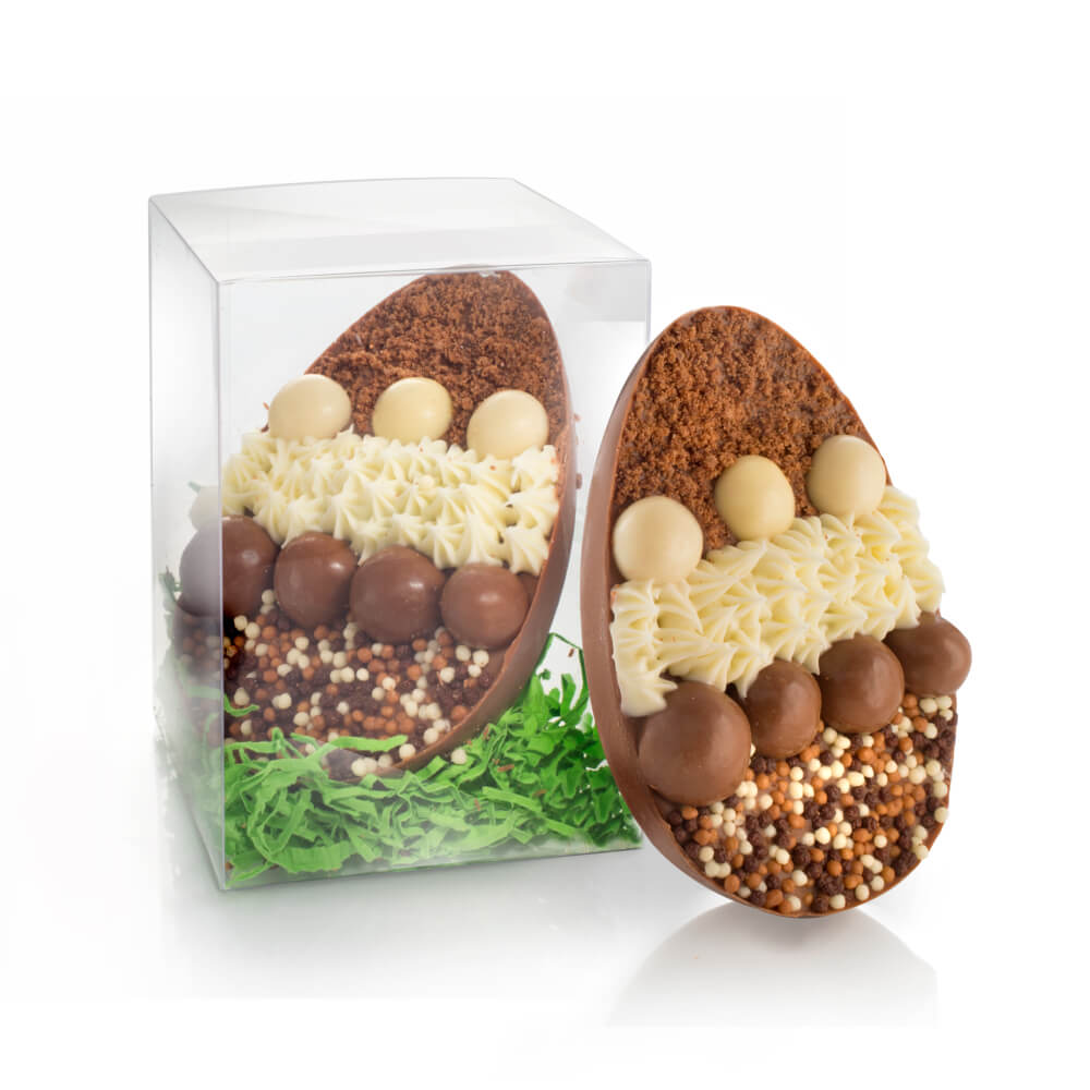 Truffle-filled Chocolate Easter Egg handmade with Belgian milk chocolate and topped with chocolate riceballs and white chocolate ganache.