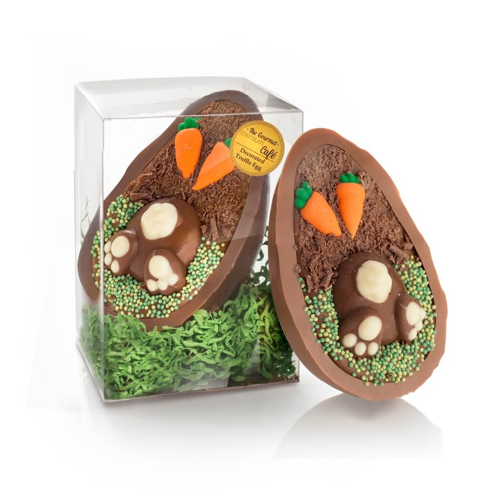 Digging Bunny Truffle filled Chocolate Easter Egg shown in and out of packaging