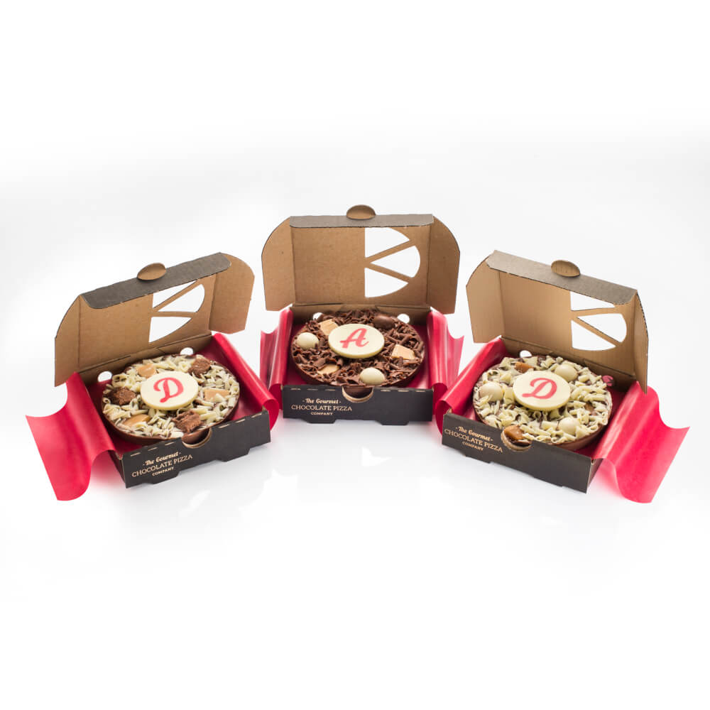 "DAD Mini Chocolate Pizza flavours include one 4"" Crunchy Munchy, one Heavenly Honeycomb and one Salted Caramel."