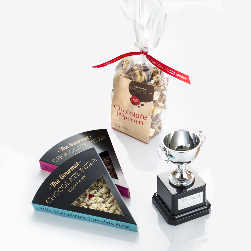 Hamper includes two of our best-selling chocolate pizza slices, a bag of Chocolate Drizzled Popcorn and trophy