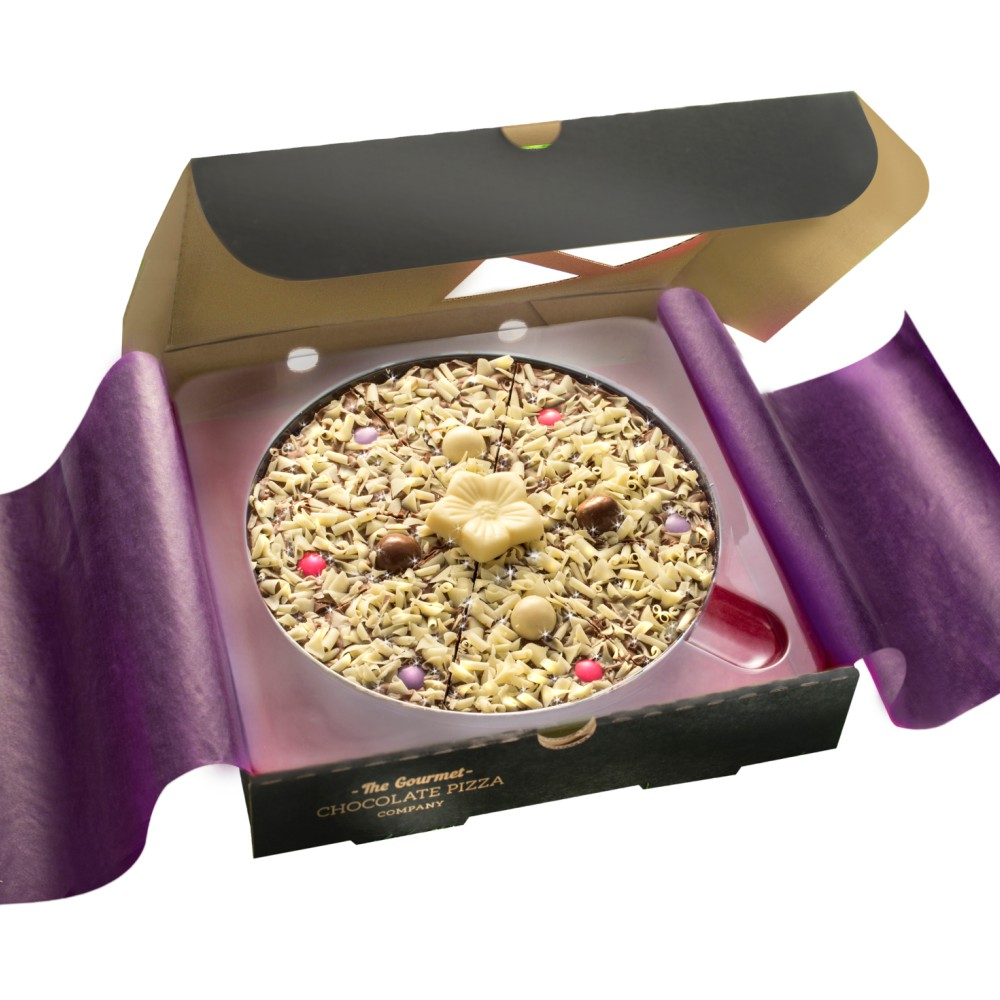 Our Mother's Day Flower Chocolate Pizza sees white chocolate curls, and pink and purple rainbow chocolate drops nestled on a solid milk chocolate base, with a white chocolate flower plaque adorning the centre.