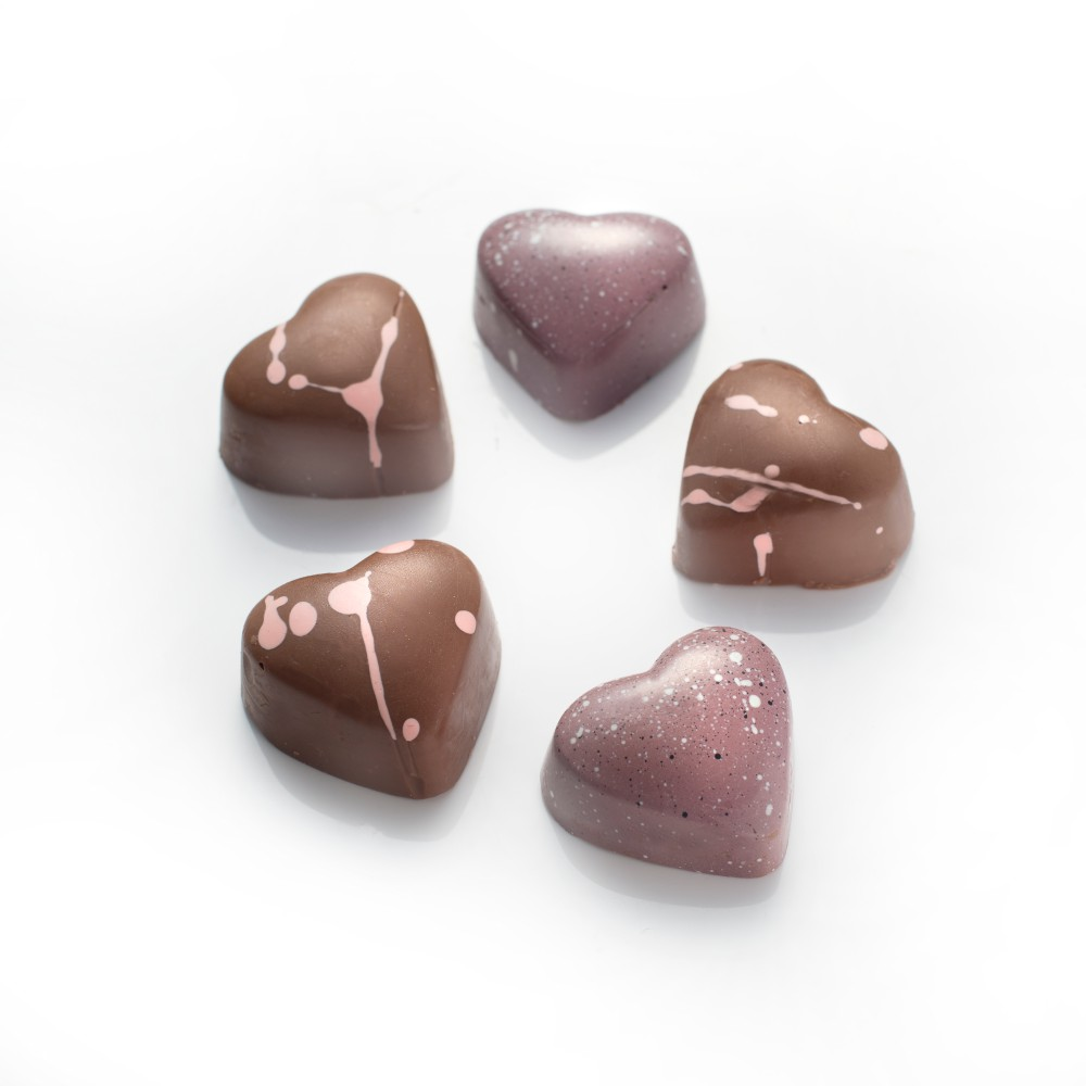 Beautifully decorated milk chocolate hearts to show someone you care