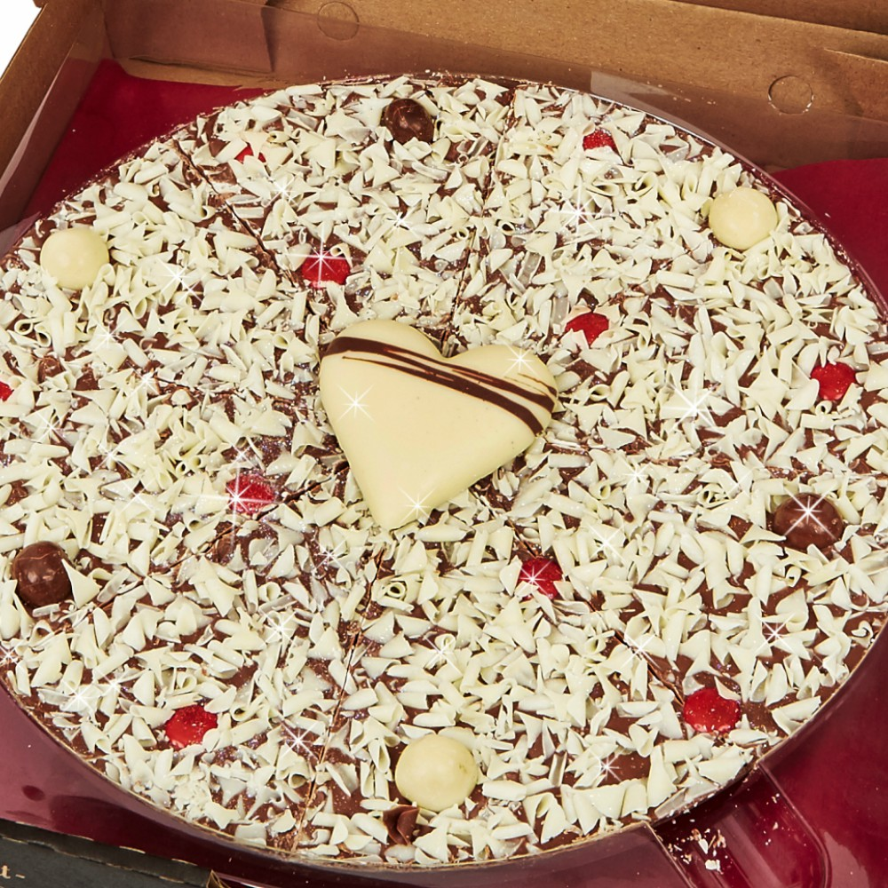 "Our 10"" Valentines Pizza is finished with a handmade solid Belgian white chocolate heart"