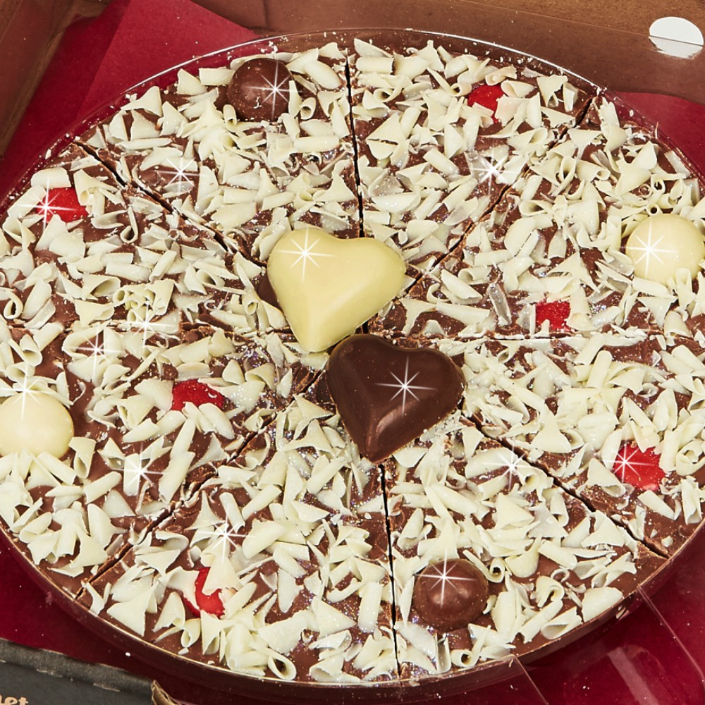 "Our 7"" Valentines Pizza is finished with handmade milk and white chocolate hearts"