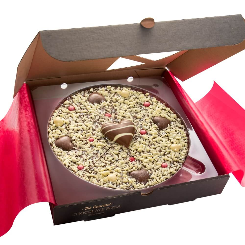 "Our 10"" Valentines Day Chocolate Pizza is presented in a stylish black pizza box with red tissue paper."
