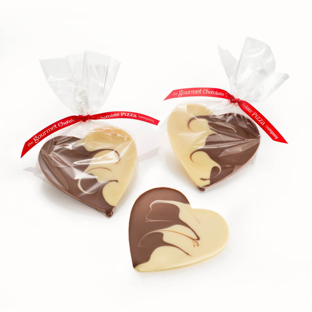 Milk & White Chocolate Hearts, presented in a clear gift bag with hand tied ribbon.