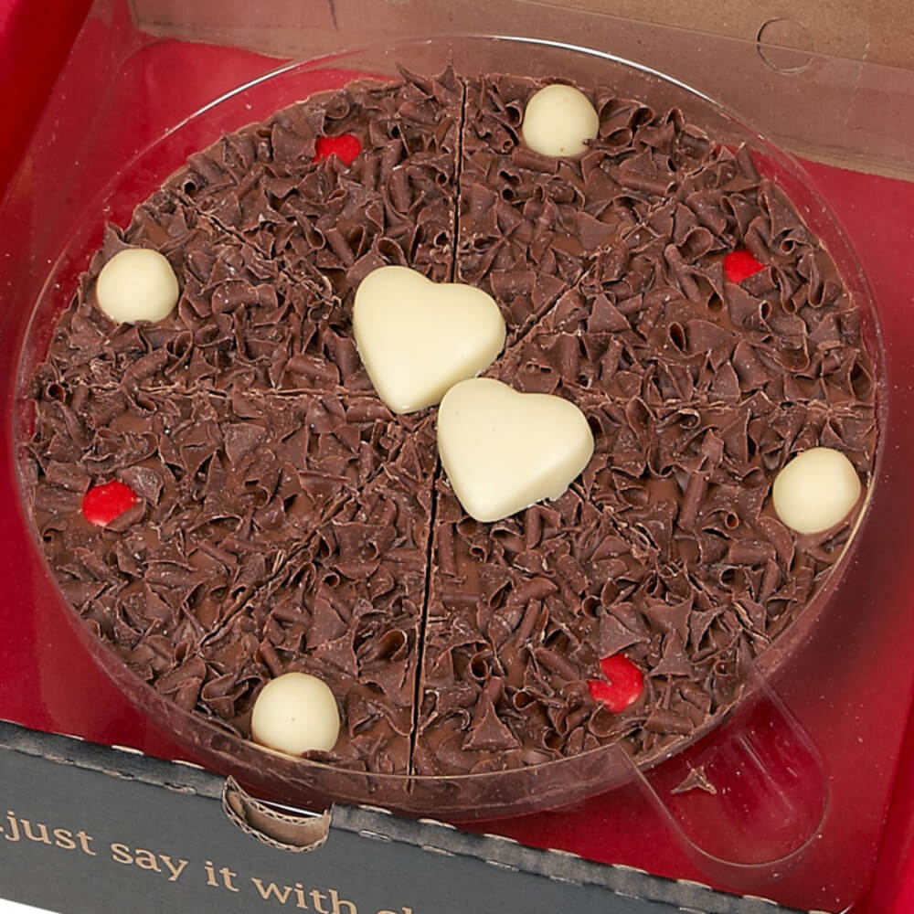 "7"" Valentines Day Chocolate Pizza, with milk chocolate curls, white crispy balls and red rainbow drops. Finished with two handmade white chocolate hearts."