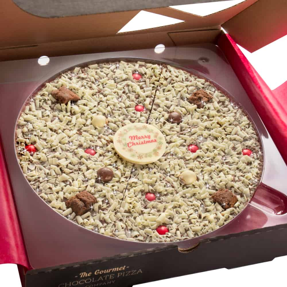 10 inch Christmas Chocolate Pizza features milk and white chocolate rice balls, festive red rainbow drops, crunchy brownie biscuits and is finished with a white chocolate plaque.