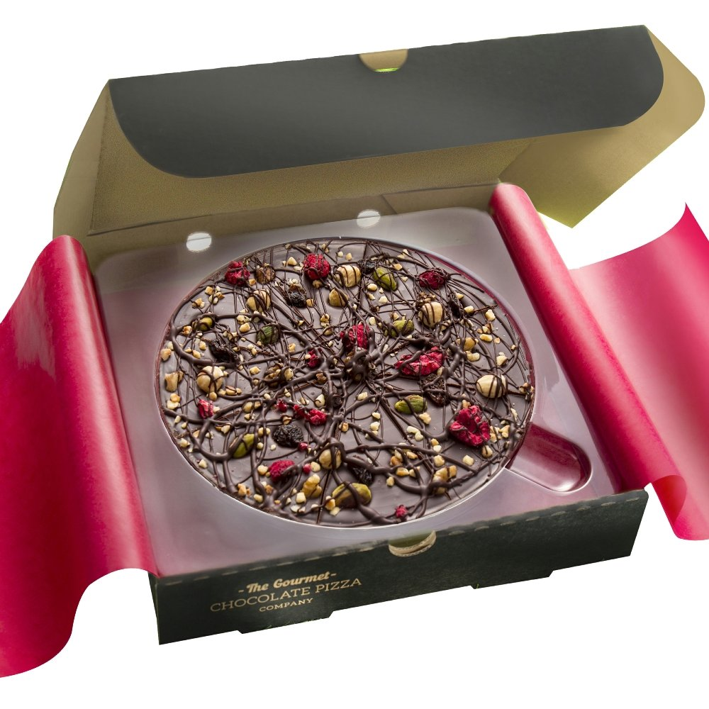 Vegan-friendly Decadent Dark Chocolate Pizza decorated with fruit and nuts