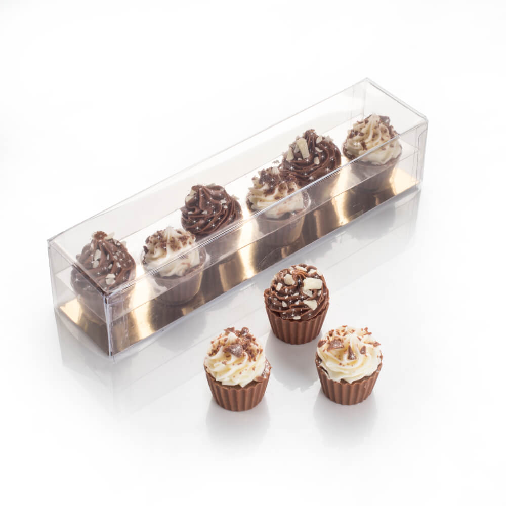 Mini Chocolate Cupcakes topped with a vanilla or milk chocolate swirl, decorated with chocolate sprinkles.
