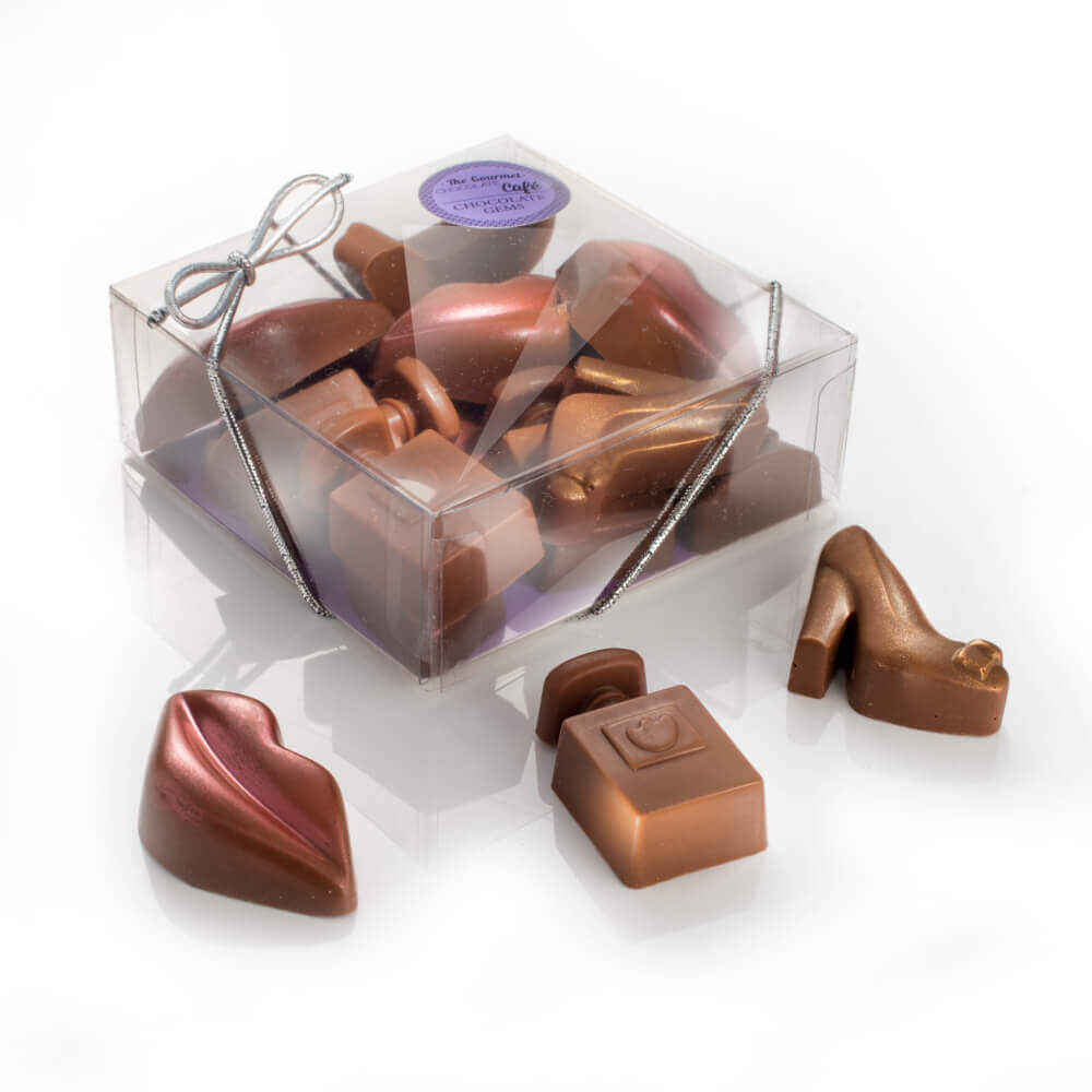 Our little Box of Chocolate Essentials features a selection of solid milk chocolates styled as lips, shoes or perfume bottles, and are finished with either a red or gold shimmer.