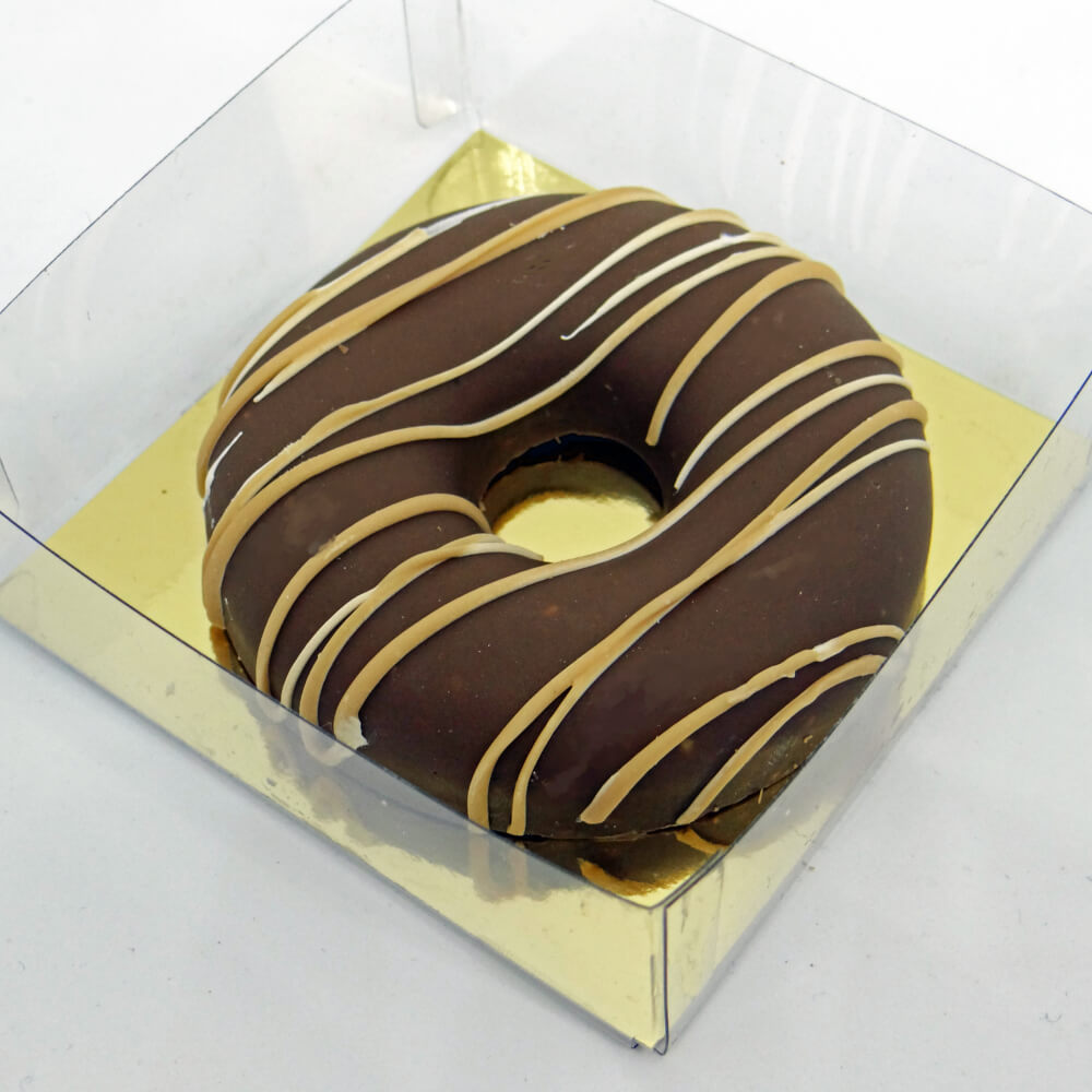Chocolate Popcorn Doughnut drizzled in Caramel Tinteretto and presented in a clear gift box